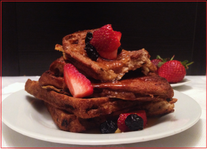 Simple and delicious oven baked French toast, served with lashing of syrup and berries.