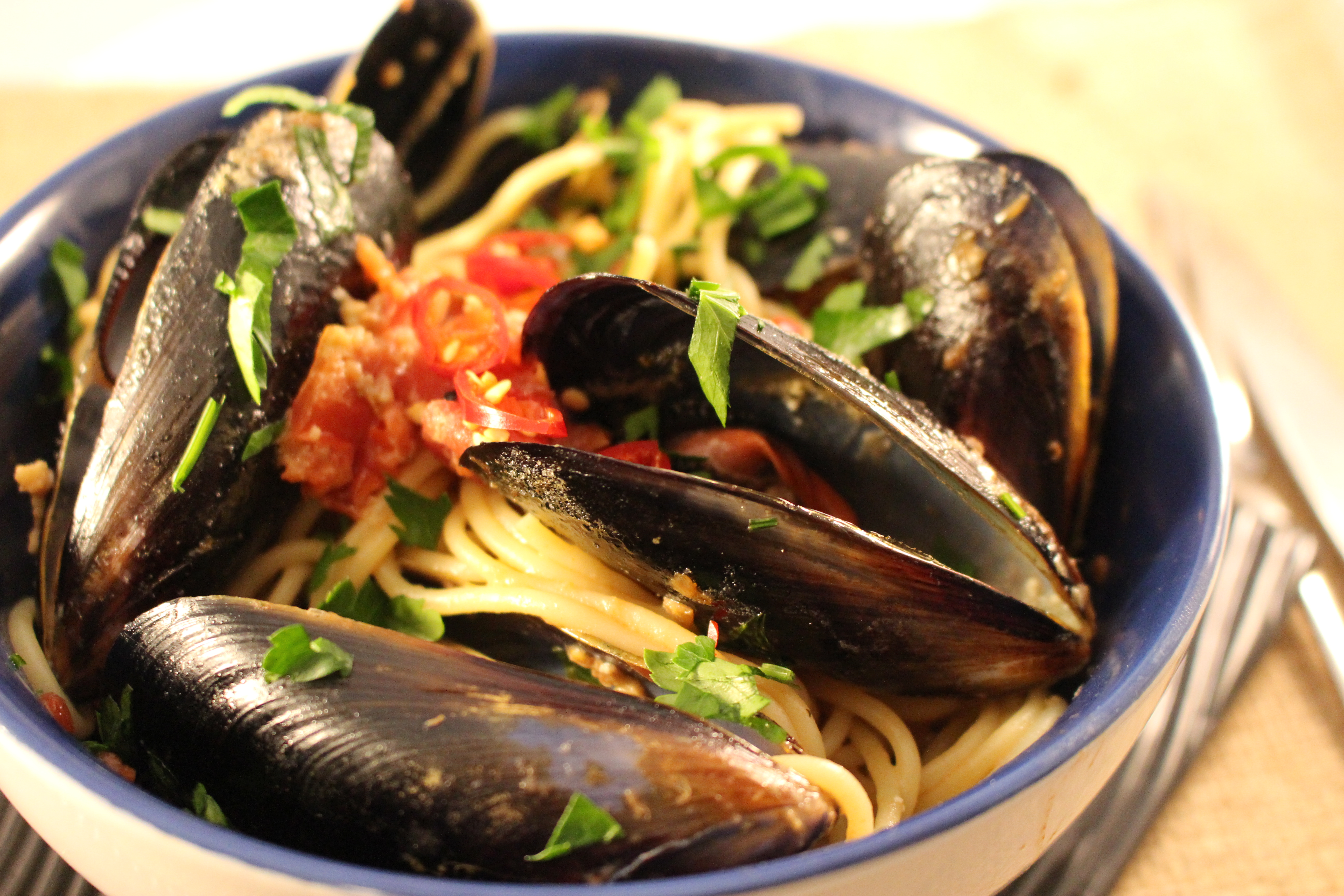 Steamed mussels Italian style with pasta
